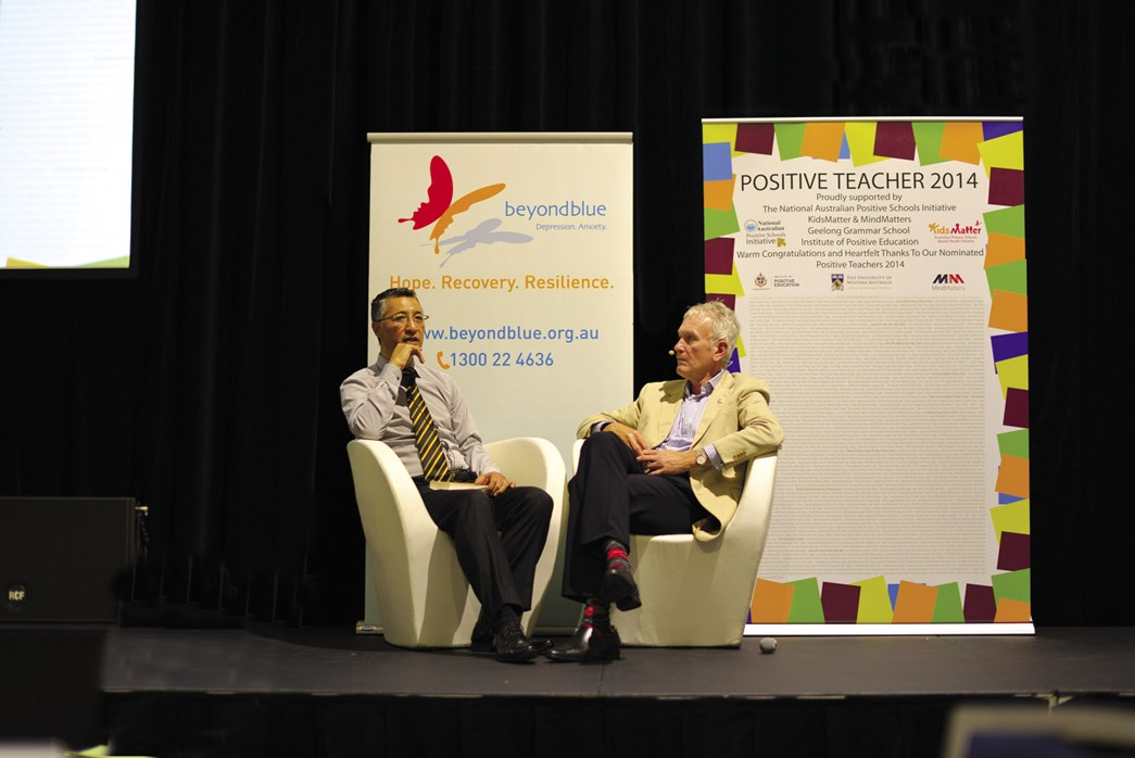 Andrew Fiu with Peter Thompson having a discussion on stage at a Positive Schools Conference, Sydney